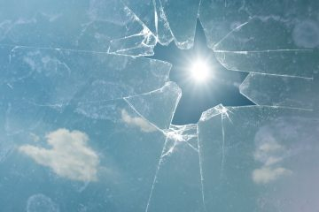 broken glass with sun shining through